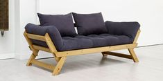 Divan Tiki.  Convertible sofa bed made of solid pine wood. It offers three different positions: double sofa, chaise longue and 80 x 200 cm single bed. Its compact size makes it the perfect spare bed for small rooms.