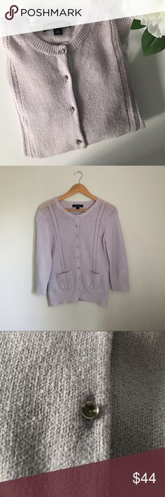 Banana Republic Wool Blend Cardigan Stunning soft lilac wool blend cardigan by Banana Republic. 85% merino wool 15% polyester. Soft & finally woven. Gorgeous crystal beaded buttons, (One button third from the bottom is missing the Crystal. Two front pockets. Size Small. EUC. Banana Republic Sweaters Cardigans