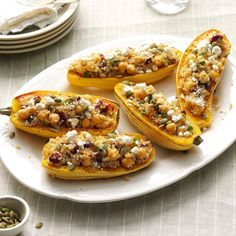 "Quinoa-Stuffed Squash Boats Recipe -My colorful ""boats"" with quinoa, chickpeas and pumpkin seeds use delicata squash, a winter squash that's cream-colored with green stripes. In a pinch, acorn squash will do. —Lauren Knoelke, Milwaukee, Wisconsin"