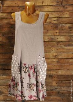Remove sleeve from a large tee shirt, add printed fabric..long enough for a dress...and make large, coordinating fabric pockets.  Wonderful.