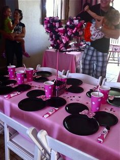 Minnie Mouse Plates.  Made with regular size paper dinner plate  2 cake plates for the ears.  You can buy the value set at Party City for super cheap!  Bows are made from scrapbook paper.