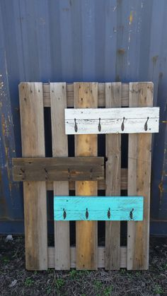 Rustic pallet coat rack / towel rack / hat rack with hooks  This pallet rack wears many hats! Whether it be to hold YOUR hats or coats in your entryway or towels for your bathroom, this multifunctional rack will work in any home. Measuring approximately 22 x 6, this rack can be finished in your choice of coffee stain, distressed white or distressed turquoise. It comes with four dark bronze double hooks and also has two hangers on the back for easy hanging upon arrival. If you need a larger…
