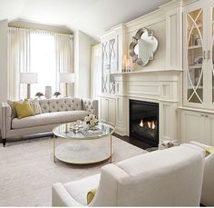 Sarah St Amand Cool, crisp living room. Custom built-ins. Neutral living.