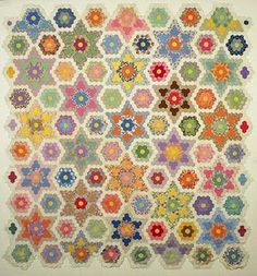My friend, Steffi (Steffi's Candy Quilts), and I are starting a quilt-a-long to make this amazing vintage Grandmother's Flower Garden quilt that Steffi found on nebraskahistory English Paper Piecing, Antique Quilts, Vintage Quilts, Vintage Sewing, Quilting Projects, Quilting Designs, Hexagon Patchwork, Hexagon Quilting, Hexagon Tiles