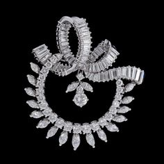A navette- trapez- and brilliant cut diamond brooch