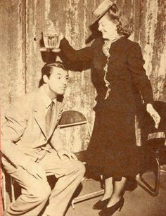 Myrna Loy helping Cary Grant celebrate his Birthday,