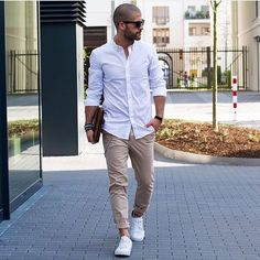White Sneakers styled with White Long Sleeve Shirt, Beige Chinos and Dark Brown Leather Zip Pouch
