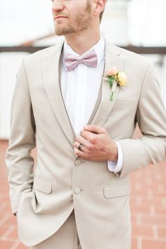 Tan suit perfect for a beach wedding