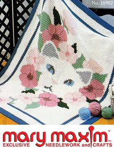 Cat and Flower Afghan.  Crochet this amazing afghan using a graph.