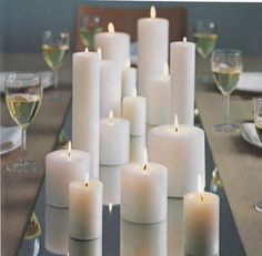 candle centerpiece. Pillars in round hurricane with sugar and pearls. Always elegant- buy these by the case and embellish as you wish for any occassion