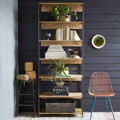 "Form, function and versatility. The Rustic Modular 33"" Bookshelf works everywhere from the living room to the dining room or home office. Supported by blackened steel frames, each piece is subtly unique, due to the natural color variations in the mango wood."