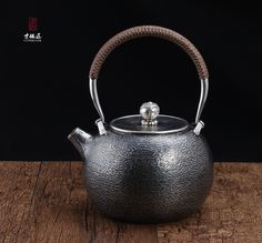 Round Hammer Marks Silver Kettle The body is round, which is hammered with irregular texture but beautiful. The handle is silver with nylon rope. It is anti-hot. The body and spout is made of one piece silver,  it is very durable without welding. The bottom is smooth with cunsilver logo.