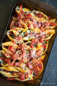 Sausage, Spinach, Ricotta Stuffed Pasta Shells ~ Jumbo pasta shells stuffed with Italian sausage, spinach, ricotta and Parmesan cheeses, covered with cooked tomatoes and baked. ~ SimplyRecipes.com