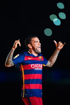 Dani Alves of FC Barcelona waves during the team official presentation ahead of the Joan Gamper trophy match at Camp Nou on August 5, 2015 in Barcelona, Catalonia.