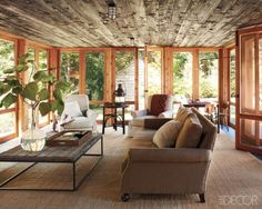 Inspiration for a current project: turning a sunroom lined in light pine into something clean and stylish.