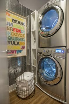Who says a laundry room has to be stark and boring? Designer Linda Woodrum created a shiny tile wall accented by colorful artwork to make the space feel fun and playful. Take the video tour --> http://www.hgtv.com/design/hgtv-smart-home/2015/hgtv-smart-home-2015-videos-videos#video-20?soc=smartpin