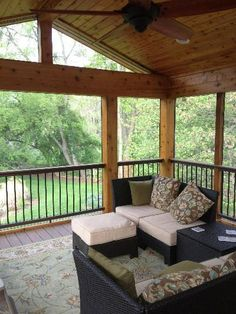 This screened-in porch displays a majestic ceiling finish with open gable roof and a sleek railing profile to maintain an open backyard view.