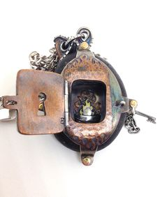 Rock Locket. a locket made from a hollowed out beach rock. sterling silver and copper.  view inside the door from original by Carl Stanley