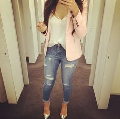 Ballerina pink blazer, loose white top, and jeans.