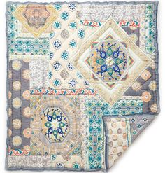 This is a fun boho print quilt.This soft cotton spread is reversible. Each piece takes 60 hands, 13 different processes, 72 hours and countless colors to create. Features: - Cotton - Imported Dimensio