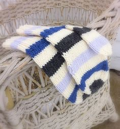 Simple Striped Mittens are worked in the round on 4 needles. Stripes are 6 rows each with Main Color carried from row to row. Simply Striped Mittens will adapt well to any stripe pattern or color you choose.