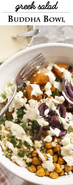 Turn Greek salad into a satisfying one bowl dinner with this Greek Buddha Bowl! It's full of chickpeas, roasted squash, pearl couscous, feta, and olives all over a bed of spinach and drizzled with a yogurt, tahini dressing. | justalittlebitofbacon.com