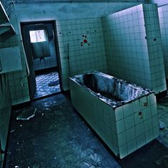 Well this is freaky. looks like blood in the tub and on the walls. Abandoned psychiatric institute.