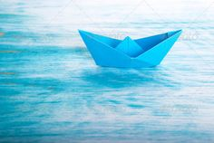 Boat alone in the Sea ...  abstract, adventure, alone, background, boat, business, concept, conceptual, copy space, copyspace, desolate, discover, discovery, fear, holiday, holidays, insurance, island, isle, loneliness, lonely, miniature, ocean, one, origami, paper, reach, recreation, relax, relaxing, rescue, safety, sailing, sea, security, ship, shipping, sign, sports, symbol, toy, transport, transportation, travel, traveling, vacation, way