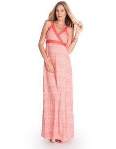 A summer staple, our Aztec Maternity Maxi Dress is made for sun, sea and sand. Crafted in soft stretch jersey, it drapes beautifully to the ground, elongating your silhouette and offering a flexible fit for every stage of pregnancy. Solid coral straps and sash ties highlight the empire waist, providing the perfect contrast to the stunning Aztec print, while a sexy split to the knee completes the look.