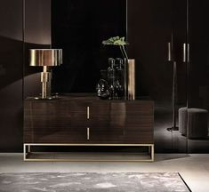 This black cabinet has an incredible impact on the room's overall feel | Modern Cabinets | Contemporary Cabinets | Modern Buffet | For more inspirational ideas take a look at: www.bocadolobo.com