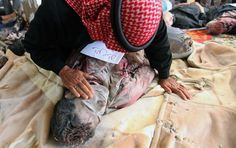 A father mourns his dead son in the province of #Daraa, #Syria #FB