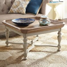 "Antique white     33.20""W x 33.20""D x 19""H     Acacia wood, engineered wood     Clean with a soft, dry cloth Amelia Coffee Table"