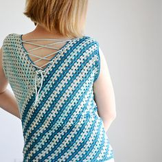 Sailmaker top is easy and quick to make and its unusual construction will keep you interested to the last stitch! The diagonal construction combined with alternating solid and variegated yarns brings out the best of both yarn colors, creating a watercolor-like effect.