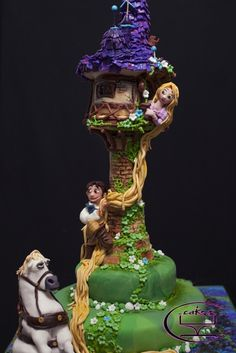 Tangled-themed Cake - I spent 72+ hours on this cake I did for Icing Smiles. Running on 2 hours of sleep, I was gently reminded that it was all worth it when I saw the little 8 year old girl battling cancer smile when she saw her birthday cake. :)