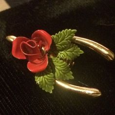 Enamel rose on gold plated wish bone pin A perfect addition to a vintage or holiday wardrobe. Vintage Jewelry Brooches