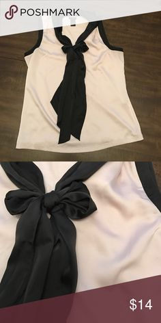 ANN TAYLOR Blouse Excellent condition. Pale pink with black tie accent in front Ann Taylor Tops Blouses