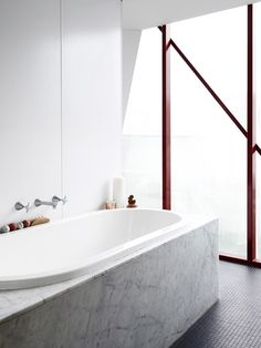 Marble bath in the home of Amber and Ben Clohesy shown on The Design Files