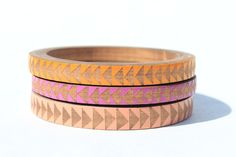 Skinny stacked bangles with triangle pattern.