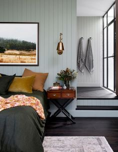 A very calm bedroom with dark floorings, dark furnitures, dark bedding, but muted walls