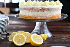 """A deliciously simple 2 layered naked cake with plenty of zip from the lemon zest, tang from the sour cream, light on frosting and skill level, but still super pretty. This """"exposed"""" cake will be enjoyed by all!"""
