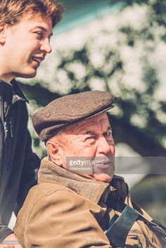 Stock Photo : happy Senior Man in Wheelchair and Grandson Outdoors, Europe