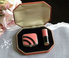 Love pink and black together. It's even more terrific on this Art Deco compact and lipstick set.