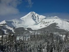Big Sky, Montana - Lone Mountain.  Seasonal workers run the resort hosting guests and play on the huge mountain right in their backyard!  Secluded and Peaceful.