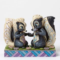 Item Number: 4049639 Material: Stone Resin Dimensions: 4.125 in H x 2.75 in W x 5.5 in L Flower and Miss Skunk from the Disney classic Bambi are a fragrant picture of romance in this heartfelt design
