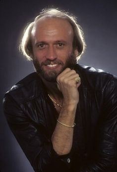 Maurice Gibb  Twin brother to Robin Gibb and brother to Barry and Andy Gibb. Group The Bee Gees
