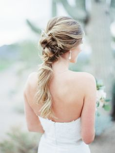 Unique twist pony tail hairstyle: http://www.stylemepretty.com/arizona-weddings/2017/02/15/arizona-desert-inspired-wedding/ Photography: Rachel Solomon - http://rachel-solomon.com/