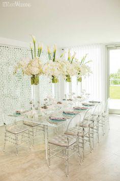 All-White Beach Wedding Table Setting with Plexiglass Decor