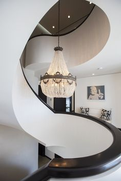 The staircase in a three-story penthouse at the top of Las Olas River House, a condominium in downtown Fort Lauderdale. The chandelier is a focal point.
