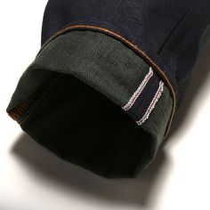 The JB0412-ML (Military Green) by Japan Blue is a burly 16.5oz. Green Weft Japanese Selvedge Denim http://www.okayamadenim.com/collections/featured-items/products/japan-blue-jb0412-ml-slim-tapered