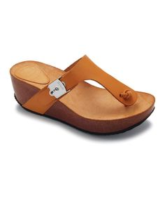 Slide into easy style with these classic platform sandals. Crafted in supple calfskin leather and sporting comfy construction, they'll keep feet feeling as relaxed as they look.2.75'' heel with 1'' platformCalfskin upperLeather liningMan-made soleIm...
